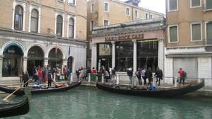 Gondola's push off in the shadows of the Hard Rock Cafe in Venice.