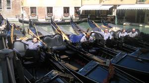 Gondoliers, awaiting passengers. These are the rock stars of Venice.