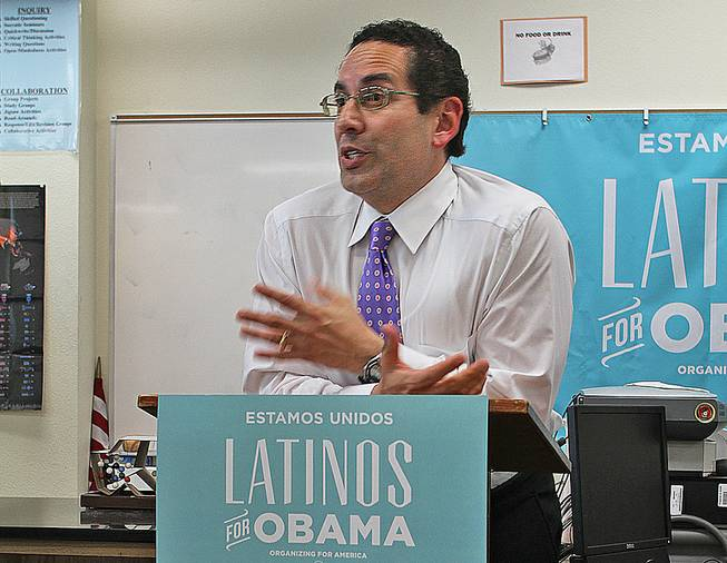 Democratic National Committee senior adviser for Hispanic Affairs Juan Sepulveda addresses the Hispanic Student Union after school at Rancho High School Tuesday, April 24, 2012. Sepulveda trumpeted President Barack Obama's programs to help students pay for college as the president campaigns for Congress to extend a reduced interest rate for federal student loans that is set to expire in July.