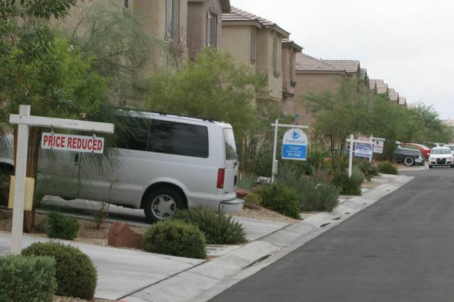 Foreclosed homes for sale line the 9800 block of Fast Elk Street in northwest Las Vegas in 2007.
