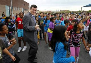 Goynes Elementary School principal Jefferey Hybarger joins students as they perform the