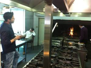 With Mateo Berucci enjoying a nice Chianti and an employe stoking a fire, Frankie Moreno sings in the kitchen of Bellavista Ristorante in Impruneta, Italy.