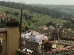 Laundry hanging in dwellings in the village of Impruneta in the Tuscan region of Italy.