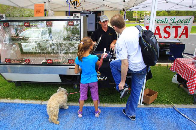 Mike Tozzi offers up samples of his sausages at the Summerlin farmers market Wednesday, April 25, 2012. Tozzi, a former construction worker, turned to making local, artisinal sausages when the construction economy collapsed.