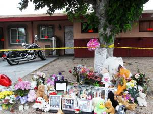 Shown is the memorial on April 25, 2012 that has been made for the mother and daughter found dead inside their home on Robin Street near Washington Avenue. On April 16, 2012, officers responded to the house when a boy, 9, went to school and told staff that his mother and sister were dead at home.
