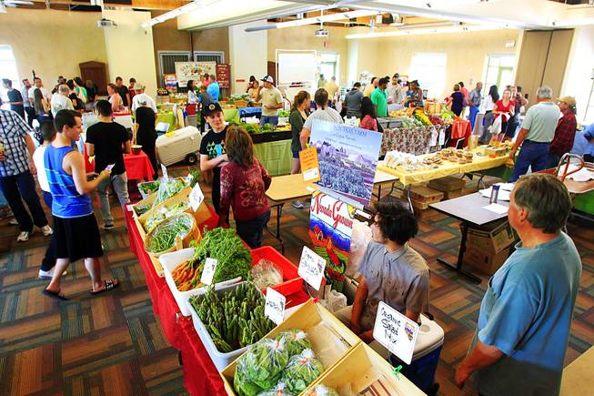 The farmers market at the Springs Preserve takes over one of its buildings Thursday, April 26, 2012.