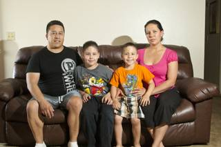 The Loya family, from left to right, Gonzalo, Jovy, Kenneth and Susana Reyes pose in their apartment, Thursday April 26, 2012. The Loyas participate in a support group at Nevada PEP for their son Jovy, who suffers from Asperger's syndrome.
