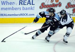 Alaska winger Scott Howes keeps the puck away from Wranglers defenseman Channing Boe during the first period of game one of the ECHL Western Conference Finals at the Orleans Arena on Thursday night.
