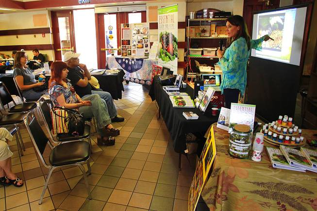 Tara Rayburn teaches a class in healthy cooking at the Downtown 3rd Farmers Market Friday, April 27, 2012.