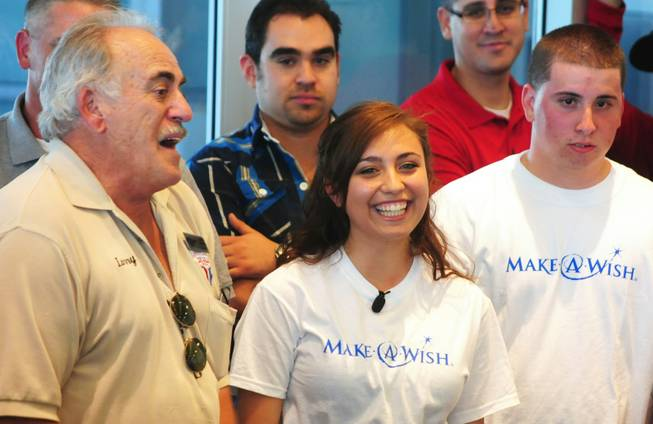 Vanessa (center) smiles as Larry Gareffa, president of Mustang and Classic Ford Club Las Vegas, talks about the various efforts it took to make Vanessa's wish for a refurbished 1967 Ford Mustang coupe come true on Saturday, April 28, 2012. The 17-year-old Centennial High School senior, who was born with a congenital heart condition, was the recipient of a car makeover courtesy of the local Make-A-Wish Foundation and its partners.