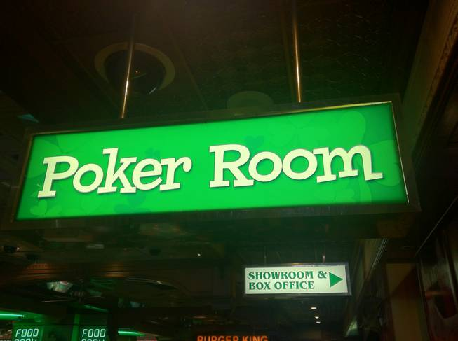 The Poker Room sign, illuminating action at four tables, at O'Sheas.
