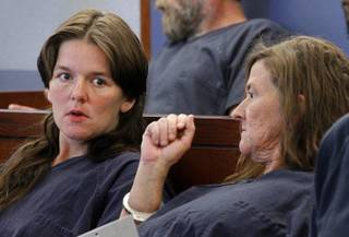 Amber Hall. left, and her mother, Lourie Rodriguez, talk as they wait to be arraigned on charges Tuesday, May 5, 2012, in Las Vegas Justice Court. The two are accused of murdering and robbing Jean Greenburg, a 73-year-old Las Vegas coin collector, on April 27, 2012.