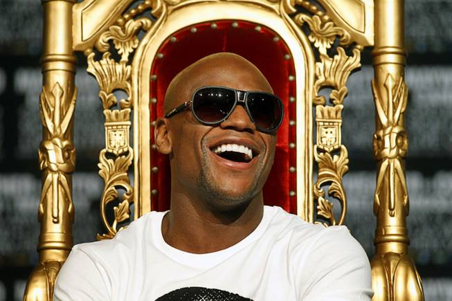 Undefeated boxer Floyd Mayweather Jr. laughs during a news conference at the MGM Grand Wednesday, May 2, 2012. Mayweather will challenge WBA super welterweight champion Miguel Cotto of Puerto Rico for the title at the MGM Grand Garden Arena on Saturday.