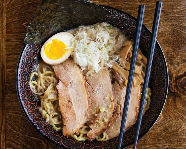 Ramen topped with pork, eggs, green onions and bamboo shoots.