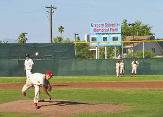 Western High School's baseball field is dedicated to former player Gregory Sylvester, who was stabbed to death in the 1980s after a basketball game. A scoreboard donated by the family, in Greg's honor, was recently installed.