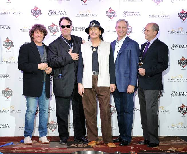 "Michael Lang, Dan Aykroyd, Carlos Santana, Chuck Bowling and Jose ""Pepe"" Hermosillo arrive at Santana's mud ceremony and the band's grand opening night at House of Blues in Mandalay Bay on Friday, May 4, 2012."