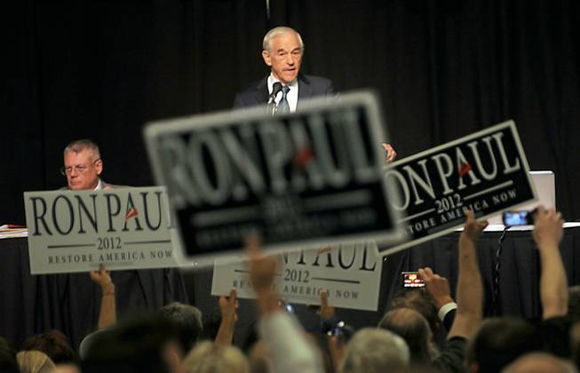 Ron Paul supporters wave campaign signs at the Nevada state GOP convention at John Ascauaga's Nugget on Saturday, May 5, 2012.