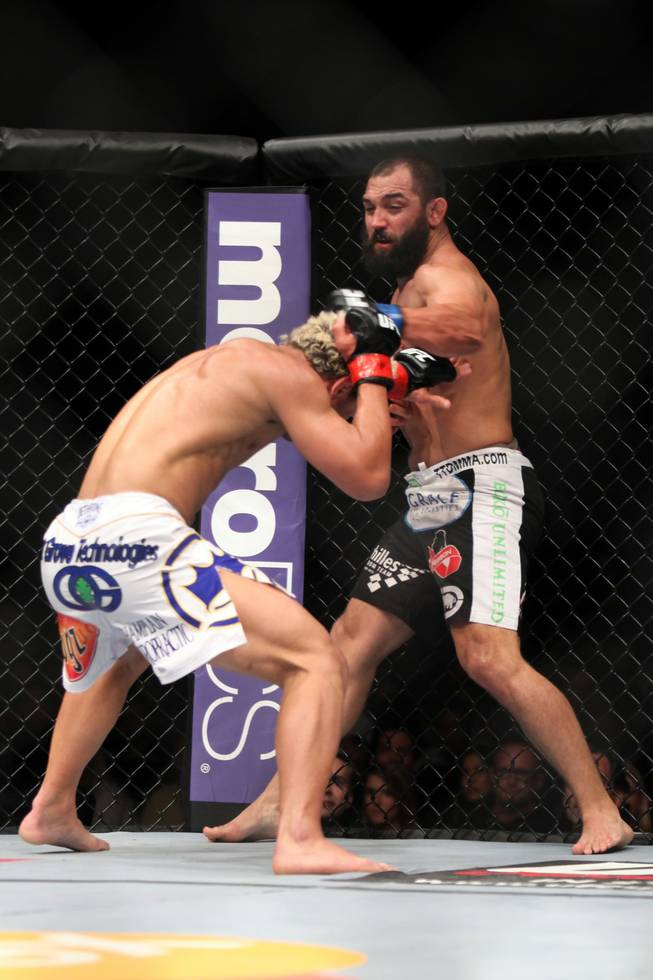 Johny Hendricks, right, lands a punch against Josh Koscheck during their welterweight bout at UFC on Fox at the Izod Center in E. Rutherford, N.J., on Saturday, May 5, 2012. Hendricks won via three-round split decision.