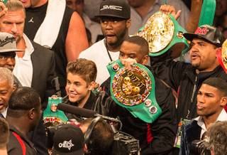 Justin Bieber and 50 Cent accompany Floyd Mayweather Jr. into the ring at MGM Grand Garden Arena on Saturday, May 5, 2012.