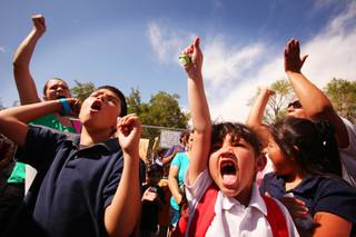 Third-grader Omar Gonzalez, left, 9 and first-grader Emelyn Martinez, 6, cheer during a protest outside of Vegas Verdes Elementary School on Monday, May 7, 2012.