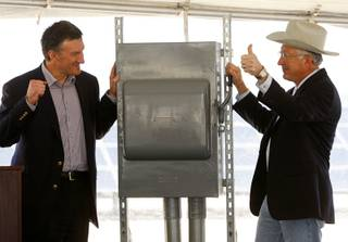 Enbridge president Al Monoco, left, and Secretary of the Interior Ken Salazar celebrate as Salazar