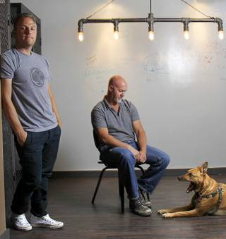 Chris Ramirez, left, founder, and Mark Balint, head of production, are shown in the Silver State Production Services offices in downtown Las Vegas Tuesday, May 8, 2012. Also pictured is Chris' dog Abby, a four-year-old Ridgeback-shepherd-lab mix.