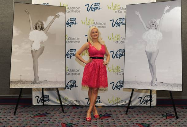 Holly Madison at a press conference at the Las Vegas Convention Center with the original Miss Atomic Bomb photograph, left, and her re-creation.