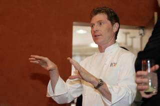 Celebrity chef Bobby Flay talks with diners about the menu before a Vegas Uncork'd Master Series Dinner at the Mesa Grill in Caesars Palace Thursday May 20, 2012. STEVE MARCUS