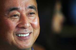Nobu Matsuhisa talks with guests during a preview of his new restaurant and hotel in Caesars Friday, May 11, 2012.