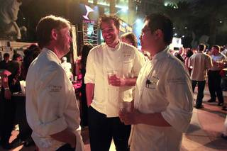 Chef Laurent Pillard from Fleur de Lys talks with Eric Beriin, center, and Andre Fru during the Vegas Uncork'd Grand Tasting Friday, May 11, 2012 at Caesars.