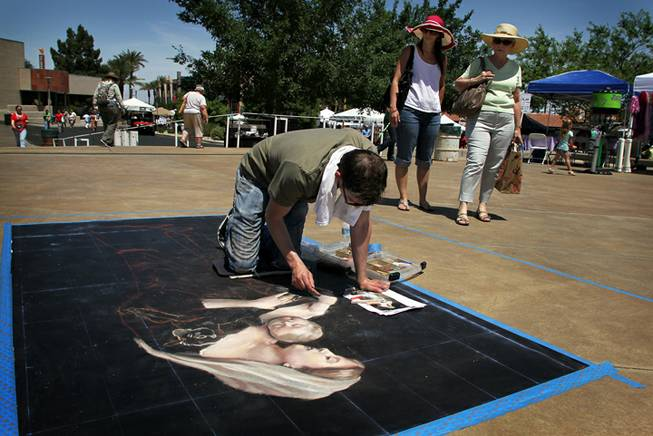 Donovan Fitzgerald, 24, works on his sidewalk chalk composition at the Art Festival of Henderson on Saturday, May 12, 2012. About 50