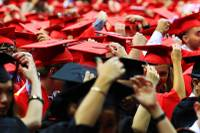 Students flip their tassels during UNLV's commencement Saturday, May 12, 2012.