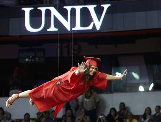 Emily Black, representing entertainment engineering's first graduating class, flies over the crowd during the ceremony on May 12, 2012. (Aaron Mayes/UNLV Photo Services)