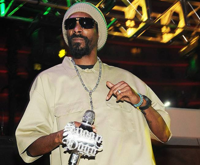 Snoop Dogg performs at the Soundwaves poolside stage at the Hard Rock Hotel on Saturday, May 12, 2012. His wax figure was on loan from Madame Tussauds for his concert.