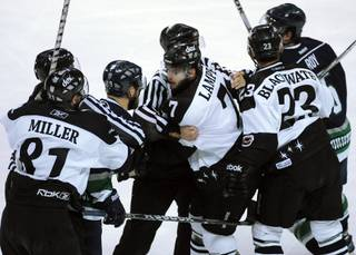 The Wranglers top line of Adam Miller, left, Eric Lampe, center, and Judd Blackwater is restrained by on-ice officials as their frustration shows against the Florida Everblades in Game 2 of the Kelly Cup Finals on Wednesday night.