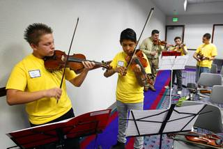 Von Tobel Middle School students Jovany Castanon, left, and Marcelino Cruz practice during a mariachi workshop led by members of Mariachi Cobre at Cashman Field Center Thursday, May 17, 2012. The students and Mariachi Cobre, from Walt Disney World's Epcot Center, will perform in the Las Vegas Latin Chamber of Commerce Mariachi Festival at the Smith Center for the Performing Arts Friday, May 18.