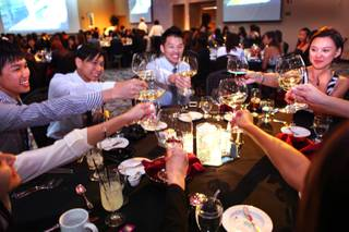 Students from Singapore learn the basics of dining decorum during an etiquette dinner at the Stan Fulton Building at UNLV on Thursday, May 17, 2012.