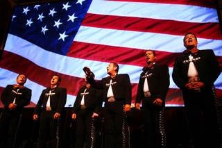 Members of Mariachi Cobre sing the National Anthem during the Las Vegas Latin Chamber of Commerce Mariachi Festival at the Smith Center for the Performing Arts Friday, May 18, 2012.