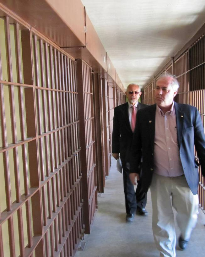 Former Nevada prison directors Robert Bayer, right, and Howard Skolnik, left, tour the Nevada State Prison in Carson City on Friday, May 18, 2012, after a decommissioning ceremony. The last inmates left months ago, and now the 150-year-old prison is being officially taken out of service.