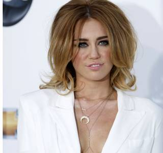 Miley Cyrus arrives for the 2012 Billboard Music Awards at MGM Grand Garden Arena on Sunday, May 20, 2012.