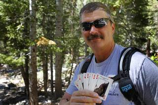 Branch Whitney, founder of the 52 Peak Club, poses with customized playing cards during a hike to Big Falls at Mt. Charleston Tuesday, May 22, 2012. Members of the hiking club try to climb 52 peaks around Southern Nevada. Each card represents a different peak. All of the peaks are within 60 minutes of The Strip, Whitney said.