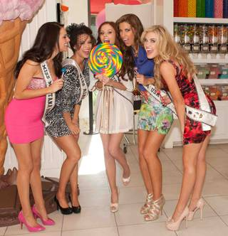 2012 Miss USA Pageant contestants with 2011 Miss USA Alyssa Campanella, center, at Sugar Factory at the Paris on Tuesday, May 22, 2012.