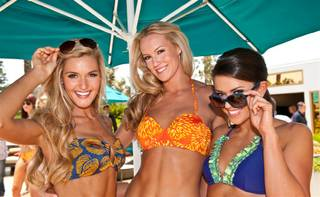 The 2012 Miss USA Pageant contestants take part in a Kooey swimwear fashion show at Trump International Hotel and Tower's pool on Wednesday, May 23, 2012.