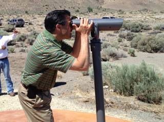 Gov. Brian Sandoval looking at pelicans at Pyramid Lake last week.