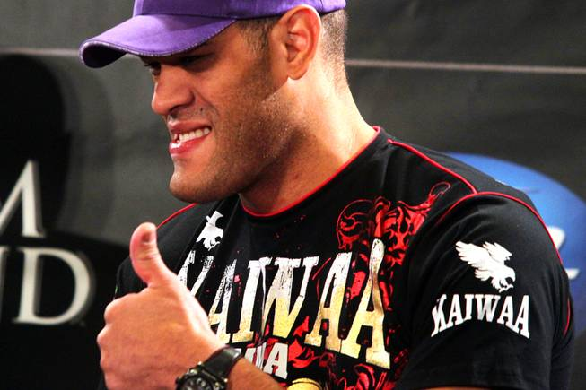 Heavyweight fighter Antonio Silva gives a thumbs up to a fan during the press conference for UFC 146 in the lobby of the MGM Grand in Las Vegas on Thursday, May 24, 2012.