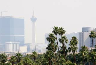 Smoke obscures the Stratosphere in this view from the MGM Grand parking garage Wednesday, May 23, 2012.  Clark County has issued an air quality advisory through Thursday afternoon due to smoke from a fire in western Nevada.