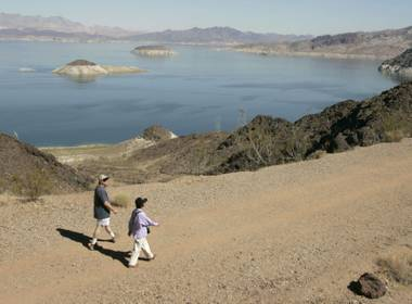 Scott Long and Ling Yee take in the scenic walk during a hike along the Railroad Tunnel trail at Lake Mead on Wednesday, Oct. 6, 2004.