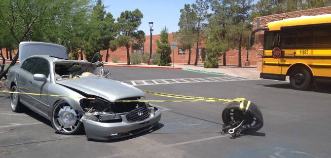 High school students who attended Clark County Commissioner Lawrence Weekly's 11th Annual Teen Town Hall were greeted by this wrecked vehicle outside the county government center Friday morning. The car had a message affixed to its side: Don't text and drive.
