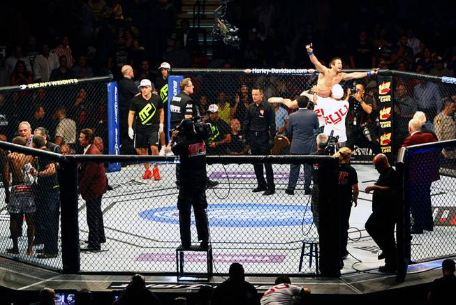 Lightweight fighter Jamie Varner, right, of Dobson Shores, Ariz., celebrates his upset win against Edson Barboza of Jupiter, Fla., during UFC 146 at the MGM Grand Garden Arena on Saturday, May 26, 2012.