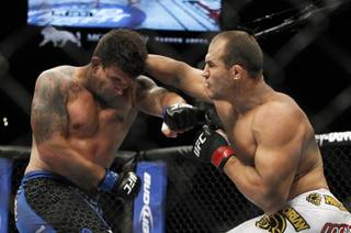 Frank Mir, left, of Las Vegas battles with heavyweight champion Junior dos Santos of Brazil during UFC 146 at the MGM Grand Garden Arena Saturday, May 26, 2012.